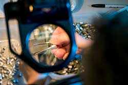 A magnify glass on a needle.