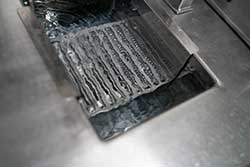 A metal rack be sterilized in boiling water.