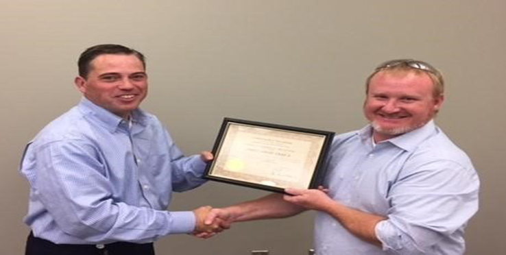 PMP Engineering Technician James Gray (right) Accepts Tool